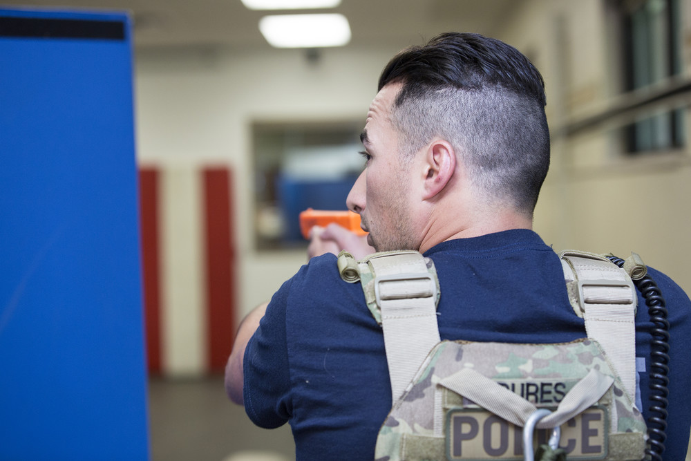 law enforcement academy student on alert in training