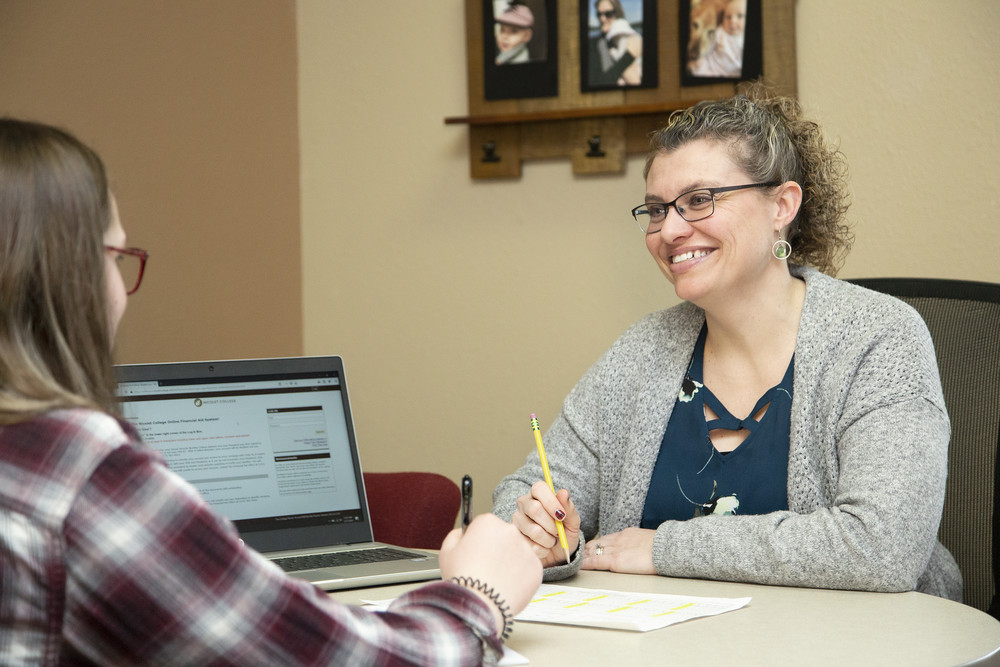 Financial Aid Advisor with student