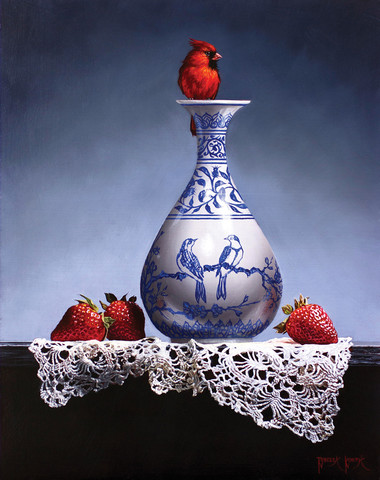 Cardinal sitting on vase with strawberries at the base